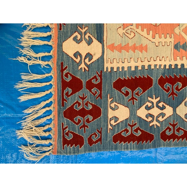 This stunning kilim area rug measures approx 3.5' x 5' and is fringed with cream tassels at either end. With classic...