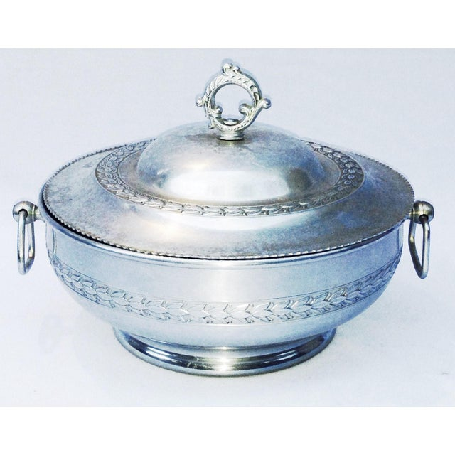 """A vintage silver style medieval, pewter aluminum server with handles and lid. There are a few bends in lid. 11"""" width x..."""