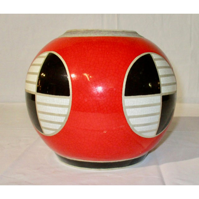 Smart stoneware or heavy porcelain body with red crackle glaze with white and black graphics. Signed on bottom Chrisco.