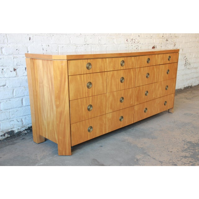 A rare and exceptional ten drawer dresser by Baker Furniture. From the only collection of residential furniture by...