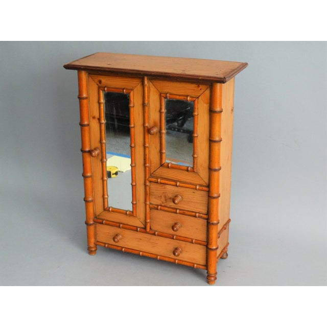 Early 20th-Century miniature French faux chinoiserie bamboo armoire for jewelry or a doll. Hand crafted of attractive...