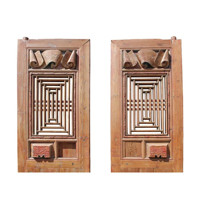 This is a pair of vintage wood door panels with restored washoff surface finish. It has dimensional scroll pattern carving...