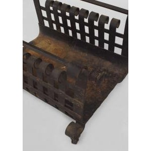 American Mission style (19/20th Cent) wrought iron log holder (magazine rack) with a scroll design sides.