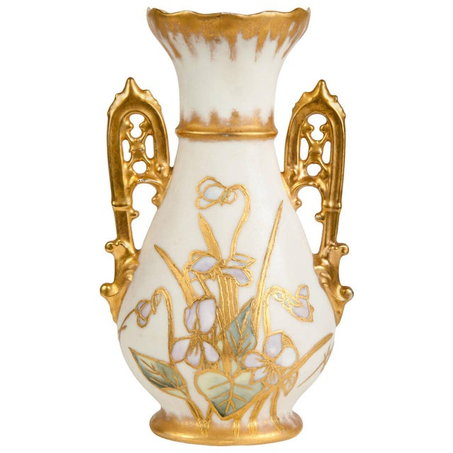 An antique porcelain vase with 24-karat gold design. Excellent condition.