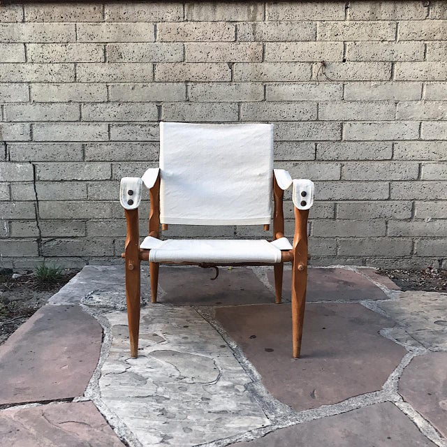 A beautiful solid teak Mid Century Danish Safari Chair with canvas seat and backing. The wood still has the original...