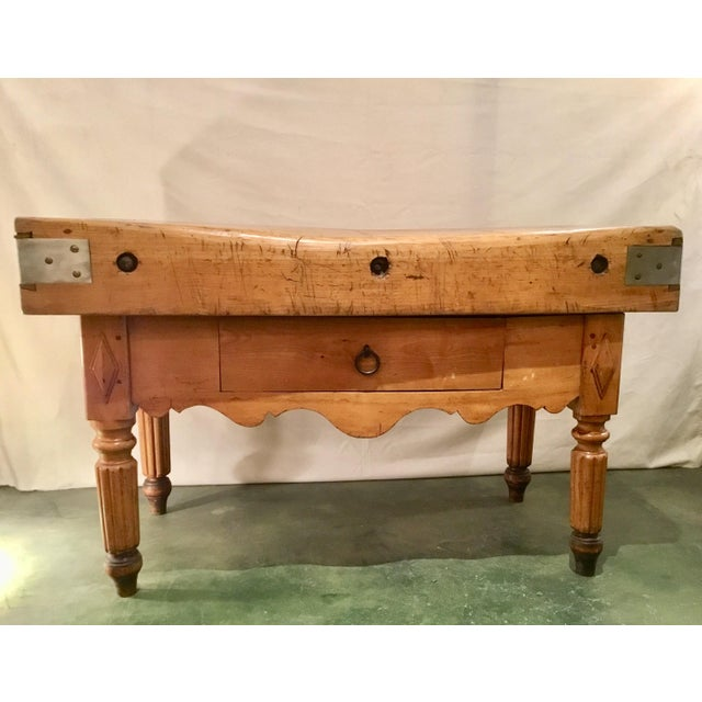 This authentic, antique French butcher block has beautiful carvings and a center drawer for ample storage. The substantial...