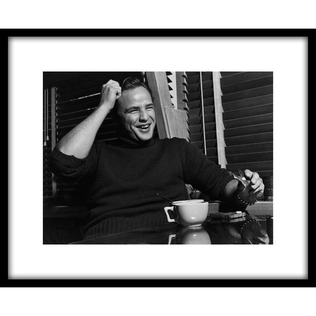 "Marlon Brando eating toast at his Beverly Glen home in Los Angeles, 1953. 11"" x 14"" silver gelatin fiber based print..."
