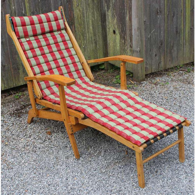 A sensational 1950's reclining and folding wood frame chaise lounge with leather straps and vintage original snap-on...