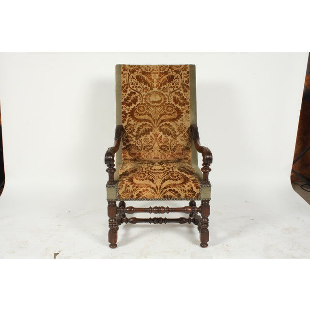 Renaissance Revival-Style armchair featuring hand-carved with floral rosettes, foliage, and elaborate scrolls in the...