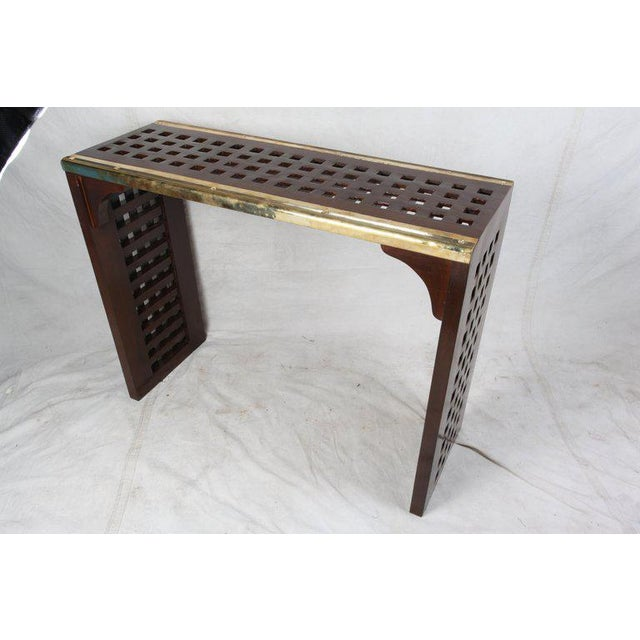 Original ship's teak decking converted to a console table with old brass stair treads used along the edges. Designed by...