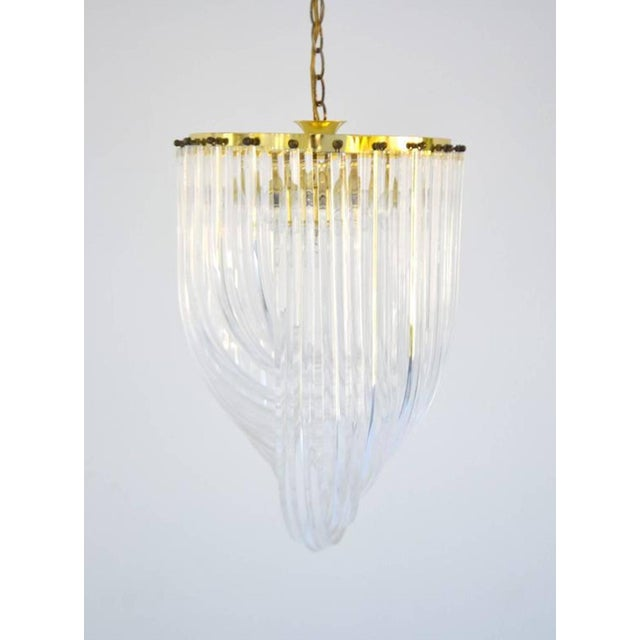 Glamorous midcentury acrylic crystal rod chandelier, circa 1960s-1970s. This sculptural round chandelier is designed of...