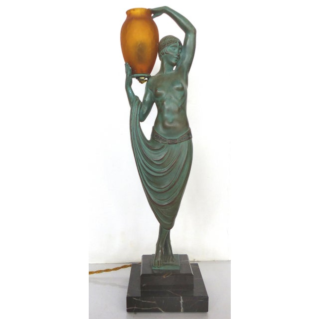 This French art deco illuminated metal statue was sculpted by Pierre Le Faguays (1892 – 1935) and cast by the LeVerre...