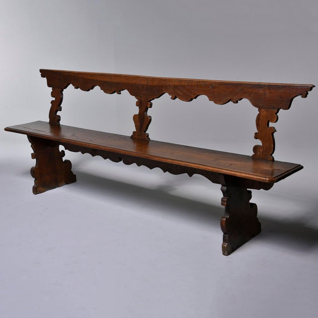 Circa 1880s Italian wooden bench features hand carved details on the top back rail, leg supports and apron. Unknown maker...