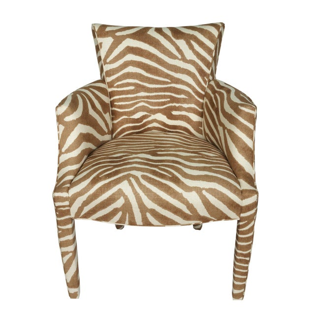 A super chic pair of vintage Donghia chairs have new life breathed into them with reupholstery in Clarence House zebra...