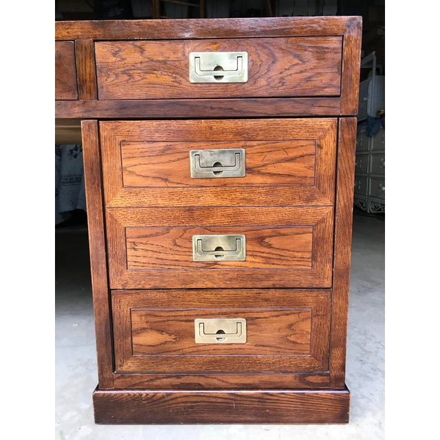 Here is a stunning Henredon double pedestal campaign desk! This oak desk has recessed brass pulls on each of the seven...