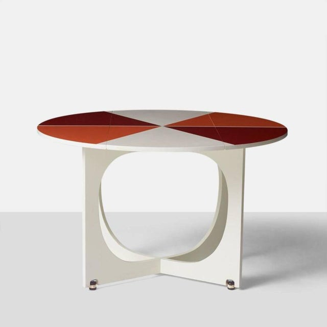 """A very rare circular drop-leaf """"Apta"""" table designed by Gio Ponti, circa 1970. The table top swivels for the leaves to..."""