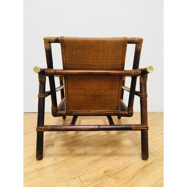Authentic signed Ficks Reed rattan club/ bergere chair. Vintage campaign style lounge chair from a difficult to find...