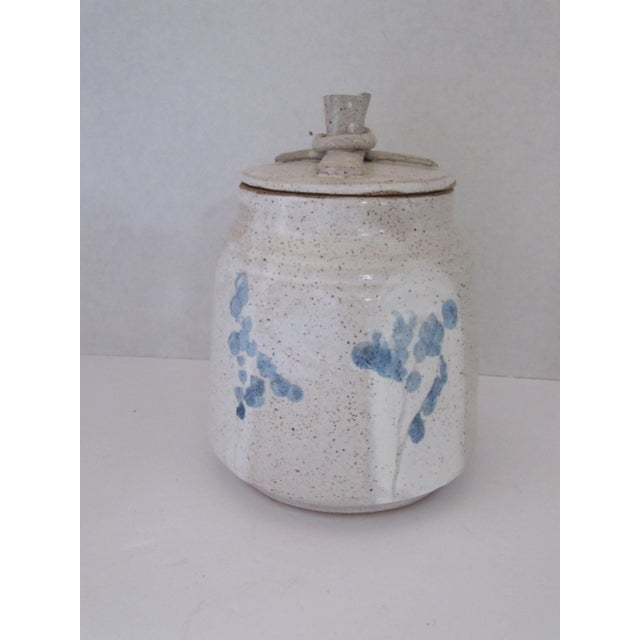 Beautiful hand made tan lidded canister with blue impressionist flowers. Great for cookies or even to store supplies on...