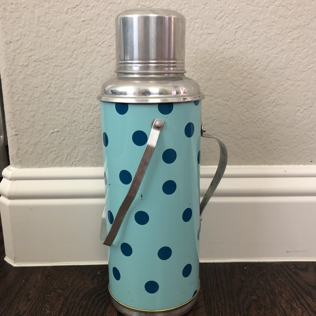 The cutest vintage thermos and cup set you ever did see! Dark teal polka dots on a light teal base. Comes with it's...