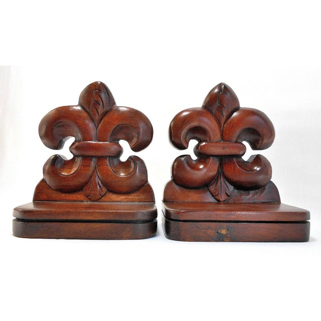 """These Fleur De Lis Bookends are hand crafted from solid Mahogany. Dimensions for each bookend: 7"""" High x 6"""" Wide x 4"""" Deep"""