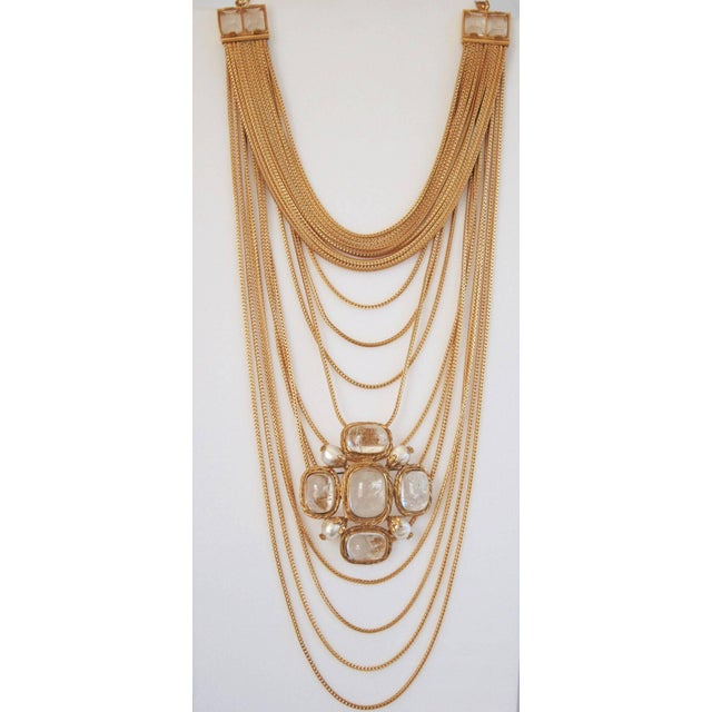 Goossens Paris gilded brass multi chain necklace with rock crystal detailing. The chains are a gorgeous shade of gold and...