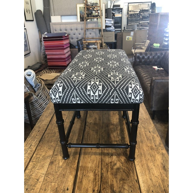 Custom upholstered faux bamboo bench featuring an Indonesian jacquard textile in black and white geometric design. We love...