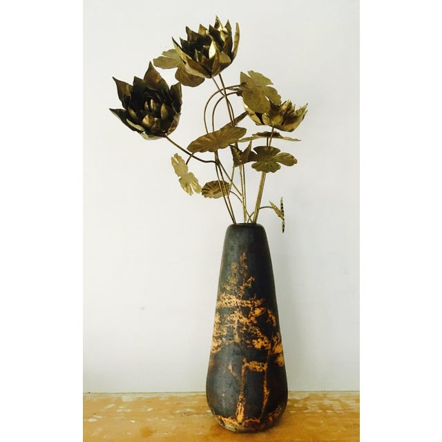 Make your statement once and for all with this brutalist Jere style floral arrangement and ceramic vase, both circa...