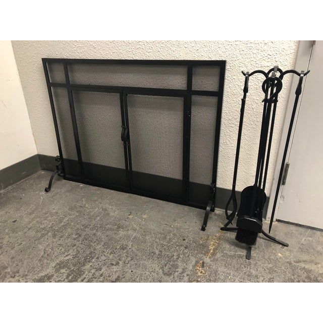 Design Plus Gallery presents an iron fireplace screen and tool set in a matte black finish. Includes shovel, brush, poker,...
