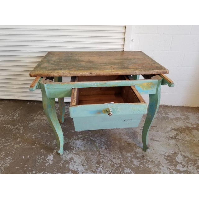 The Antique Baker's Table with Drawer originates from France. The simple, elegant, curved legs, generous drawer and apron...