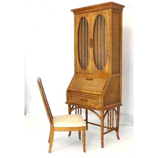 Highly decorative faux bamboo oval windows rattan secretary drop front desk cabinet bookcase with matching chair. The...