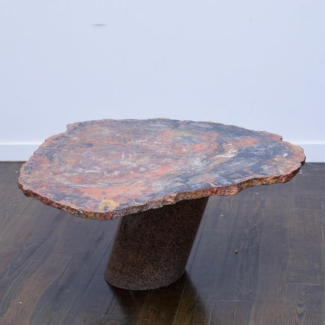 Super rare piece, most likely custom.made by Karl Springer. Table is made from a cross section of petrified wood resting...