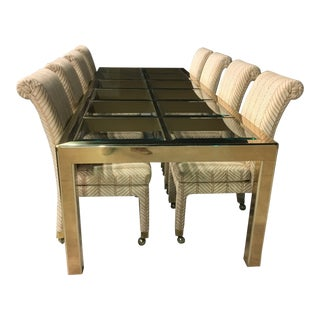 Monumental Mastercraft Parsons Style Extendable Brass and Glass Dining Table W/ Eight Rolling Chairs For Sale