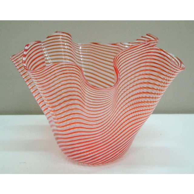 Circa 1950 A beautiful candy cane striped Murano handkerchief vase by the glass factory of Fratelli Toso handblown in the...