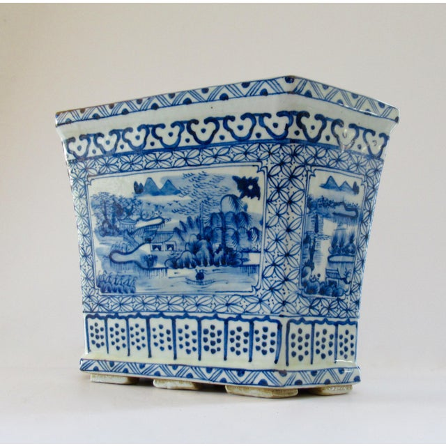 Hand-painted, decorative porcelain jardiniere/planter/cachepot in a classic hexagonal shape. This massive blue and white...