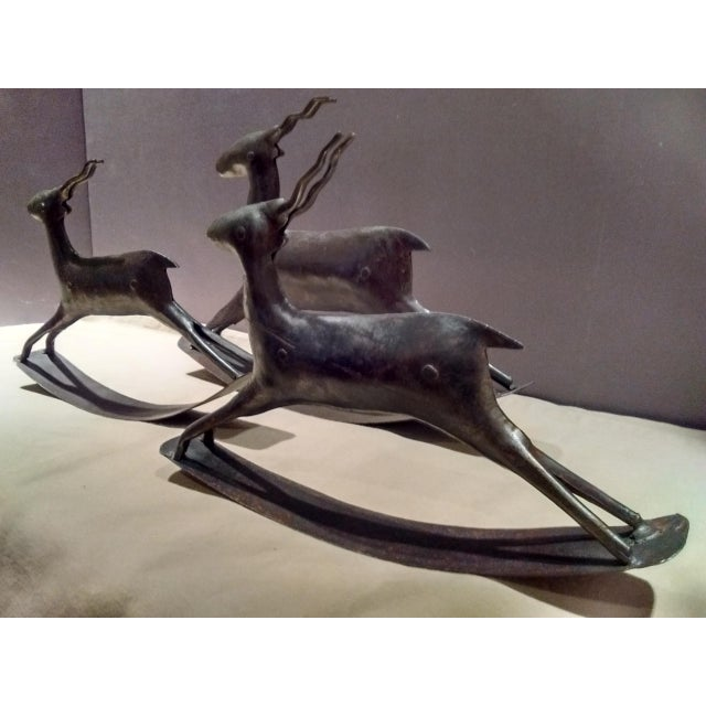 """This is a set of metal deer which includes two small (6 1/4"""" tall x 9"""" long) and one large (7 3/4"""" tall x 11"""" long) They..."""