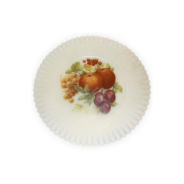 Fun and fruity, set of six fluted translucent transferware vaseline glass dessert plates with fruit motif. Nominal age wear.