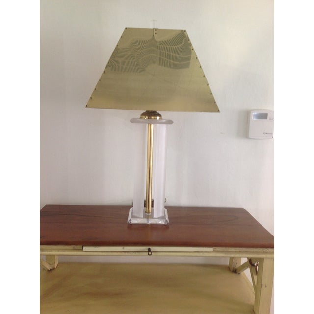 What a great pairing of two current trends... brass and lucite! The brass shade makes it extra glam!! This lamp is in...