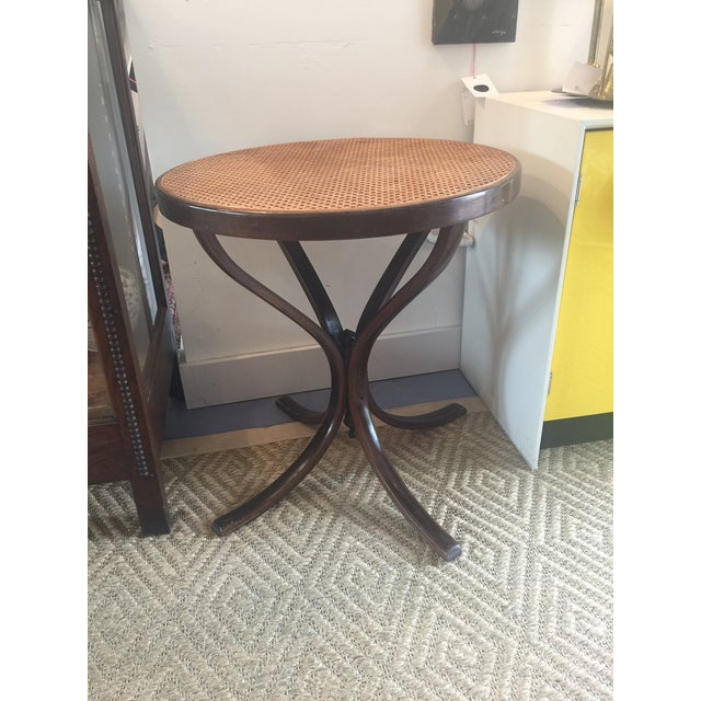 Beautiful Vintage Bentwood table with cane top in excellent shape. Would look beautiful in a small entry, beside a bed or...