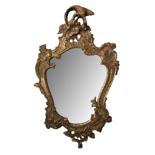 A Curvaceous Italian Rococo Style Cartouch-Shaped Carved Giltwood Mirror For Sale