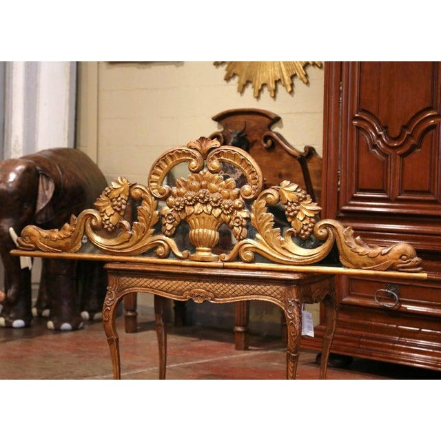 Use this architectural antique pediment as head board over a king size bed. Crafted in France circa 1780, the large...