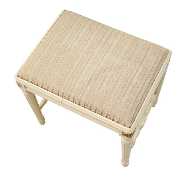 Hand carved Gustavian stool with carved floral details to each corner. Upholstered seat. Painted cream finish. Width: 45cm...