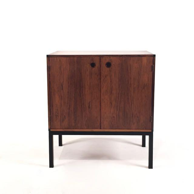 Small vintage Danish rosewood cabinet, designed by Aksel Kjersgaard and manufactured by Odder, Denmark. Cabinet is set on...