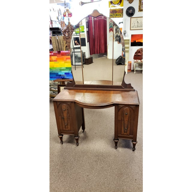 1930's Thomasville Furniture Co. Art Deco Vanity with Mirror. Charming piece with four pull out drawers. The mirror is in...