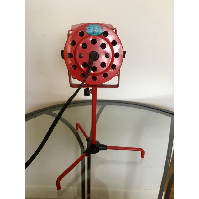 This Bright Red Enameled Metal Spotlight looks like its right off of an old Hollywood movie set. This piece will add a pop...