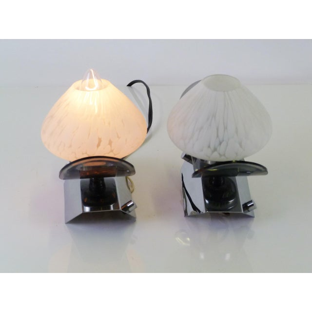 Modern blown Murano globes, smoked lucite wings and bright chrome bases, these Italian sconces are a modern vision. A...