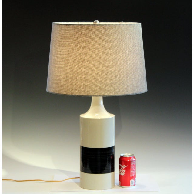 Vintage hand turned Arabia Finland porcelain lamp in stark minimalist black and white design, circa mid 20th century....