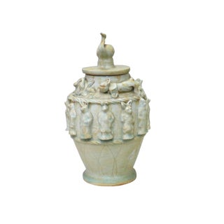 Chinese Handmade Ceramic 12 Animals Relief Motif Jar For Sale