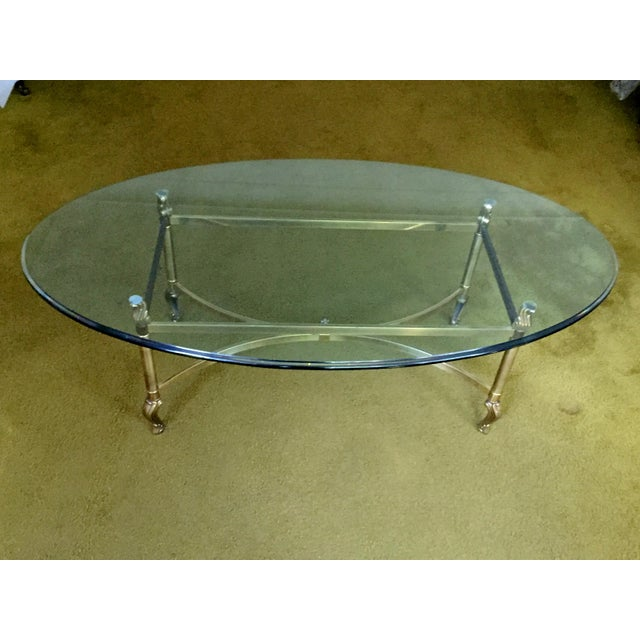"""This elegant, Hollywood Regency coffee table by renowned furniture maker La Barge has a clear, oval 3/4"""" beveled glass top..."""