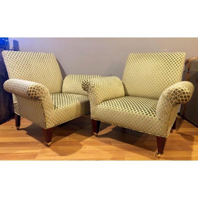 This pair of George Smith Butteryfly Chairs are in excellent condition. They are in a symmetrical diamond patterned...