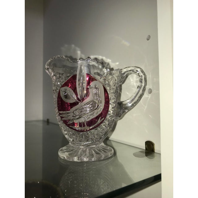 Amaris Nachtmann Hofbauer Byrdes German lead crystal footed creamer with Red background accent and carved bird. This...